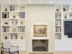 White fireplace surround & bookcases