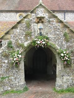 victorian flower arrangements, the doors, wedding church entrance, wedding flowers, full arch
