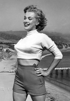 marilyn is rocking high waisted shorts and crop top