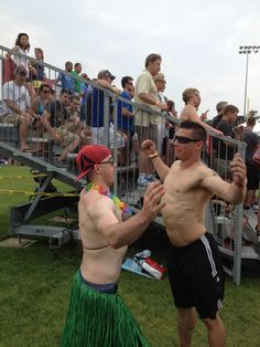 Myself and friend Tony chest-bumbing with a crowd staring at our shenanigans