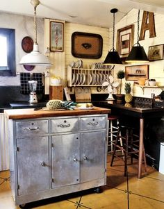 Kitchen island.  Could do with old dresser, but rivet copper repousse panels onto punched tin for door/drawer facings.  Pulls should be beaded copper wire loops.  Reuse old butcher block table top stored in shed.  Give it a knife slot.  Consider that it could be a raised work area essentially attached to an informal dining room table/nook.