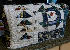 Adorable Quilted Sewing Machine Cover, with flying geese and scrap fabric!