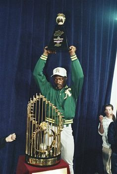 Oakland Athletics pitcher Dave Stewart holds up the Most Valuable Player trophy as he stands in front of the World Series trophy after the A's swept the series Saturday night, Oct. 28, 1989 in San Francisco. Stewart, who won both Games 1 and 3, was named World Series MVP. (AP Photo/Paul Sakuma).