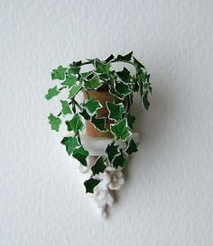 Miniature ivy in a pot on an 'alabaster' wall sconce, in 12th, one inch scale
