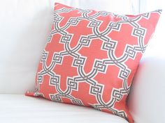 Coral and navy pillow