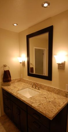 StarMark cherry java cabinets with leathered white springs granite countertop and Kohler Memoirs sink.
