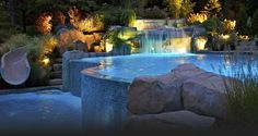 Impressive swimming pool with waterfall and even a small water slide!