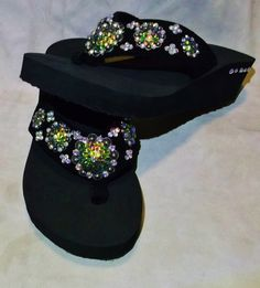 Western Cowgirl Multi color crystals on conchos make these flip flops really stand out. Sizes 5/6, 9/10    $35.00  www.pamperedcowgirl.com multi color, flip flop, color crystal