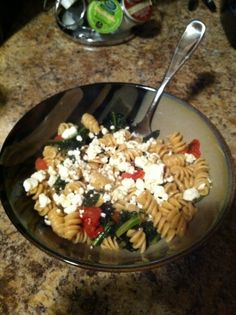 Whole wheat pasta with sautéed spinach, canned chopped tomatoes, garlic, and feta!