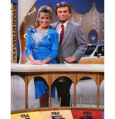 Vanna White and Pat Sajak on the set of Wheel of Fortune.