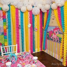 Rainbow dash would <3 this party room! All it takes is colorful streamers, white paper fluffies and lanterns for *clouds*, and a My Little Pony party game poster. Adorbs!
