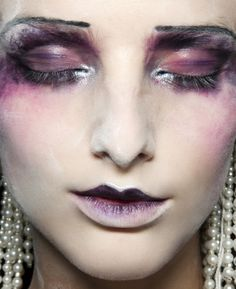 i believe this is makeup artist pat mcgrath for john galliano.