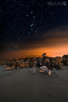 Astrophotographer Aaron D. Priest sent in a photo he took of fellow astrophotographer  Jon Secord shooting the breakwater and night sky on the beach of Wallis Sands State Park in Rye, New Hampshire, December 28th, 2013. Orion constellation soars through the sky overhead.