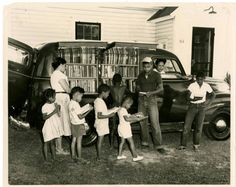Children line up beside the Albemarle Regional Bookmobile in Northampton County, North Carolina.