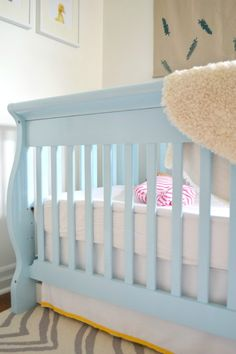 Love the soothing color of this crib. #nursery