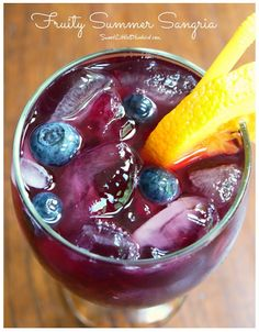 Fruity Summer Sangria Recipe - This just looks like Summer in a glass! Perfect for all the outdoor parties over Summer