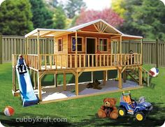 Playhouse with a deck and sand pit - and slide. Very good idea, haven't seen one quite like this before!