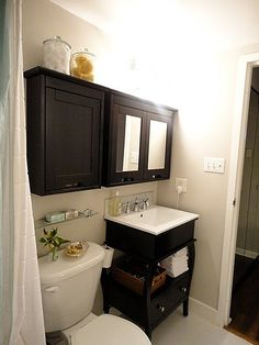 #bath Nice storage idea for a small bathroom. . .not sure if it would make the bathroom seem even smaller, though, having the bulky cabinets on the wall