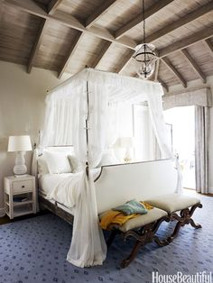 willowy canopy and Fabricut's Strondak curtains in the master bedroom of a Georgia beach house