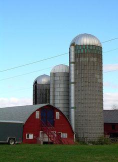 Red barn and three silos