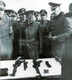 Hitler is presented with the prototype of the MKb 42 (Haenel) battle rifle, forerunner of the StG 44, in 1943. On his right is Albert Speer, the armaments minister. According to some, Hitler was unaware of the development of the battle rifle and his facial expression seems to reflect his dislike of being surprised. The Haenel had a production run of 10,000 before it was replaced by the StG 44.