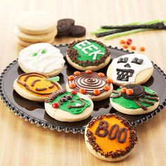These cute decorated cookies are sure to be a hit. See how to make these and get more cookie ideas: http://www.bhg.com/halloween/recipes/easy-ways-to-decorate-halloween-cookies/?socsrc=bhgpin090312halloweendecoratedcookies