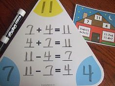 Fact family practice with triangle white erase boards