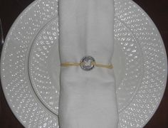 Butterfly celebration of life ring.  If you are serving a meal at the funeral or life celebration you are planning, you may want to wrap the pocket ring around the silverware with raffia or ribbon. #funeral favor #funeral gift #Next Gen Memorials