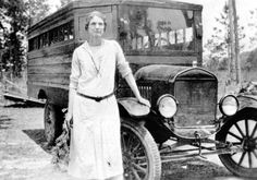 Mandie Brown standing next to the first bus in Walton County.  192-