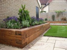 Raised flower bed - like the way the tiles and grass are layed - modern modern flower bed, bed designs, front yards, rais bed, flower beds raised, raised bed flowers, garden beds, raised wooden flower beds, raised flower beds