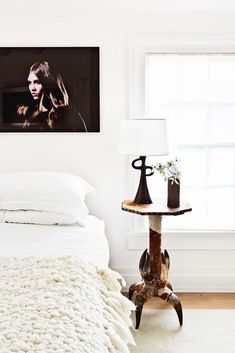 This Amazing Home is a Lesson in Sophisticated Décor, white throw, side table, nightstand, photography