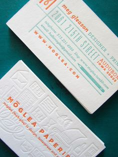 Col­or­ful orange and turquoise busi­ness cards with blind impres­sion illus­tra­tions by Meg Glea­son via Design Work Life
