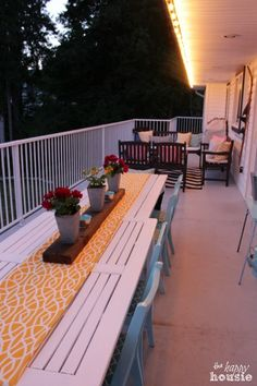 Our colorful and thrifty summer deck in evening at The Happy Housie - we used garage sale and thrift store finds to create this big dining rable!