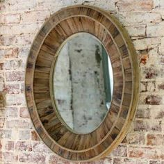 We love how reclaimed wood, with all its time worn character, brings simple beauty with minimal resources. Each radiating layer of wood, infuses this oval mirror with vintage style and charm.