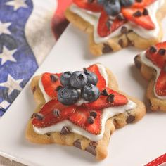 Stars and Strips Cookies ***ingredients (chocolate chip cookie dough, cream cheese, granulated sugar, strawberries, blueberries, chocolate chips)