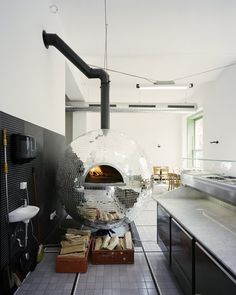 Pizza Oven That Looks Like A Disco Ball, Reflects Light As It Rotates