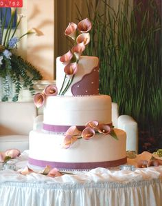 By Timothy Cake...calla lillies on white cake with lavender bands