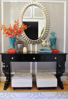 foyer with pops of complimentary colors #poshliving