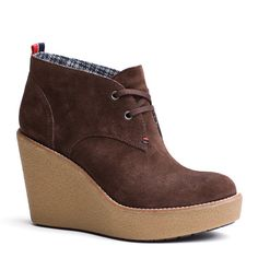 Stylish ankle boot in a smooth suede upper. Lace-up front. Tommy Hilfiger signature twin stitch at the lace-up with signature loop at the heel. Textile lining with leather sock lining. Thermoplastic rubber grip outsole with 8.5cm wedge heel for insulation and durability.