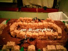 Dirt Bike Track Cake. Your mom would have a ball making this on her sheet cake :)