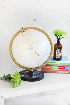 Glam up an old globe with white and gold paint. #DIY