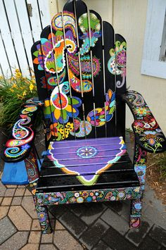 Description of . A chair titled Playful Paisley by Ashley Hadfield sits in front of Eichtens Market  Bistro in Center City. (Pioneer Pr...