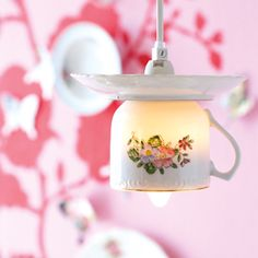 use teacups and saucers from and old tea set to make a light - great for an Alice in Wonderland themed Quince party