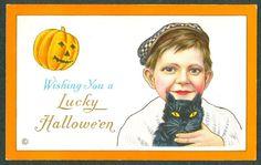 Vintage Embossed Stecher Halloween Postcard Boy With Hat Holding Black Cat