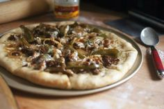 Thin Crust Cheesesteak Pizza | A classic pizza crust is topped with peppers, onions, steak and cheese, with a happy marriage of white pizza and Worcestershire sauces to hug your tastebuds.