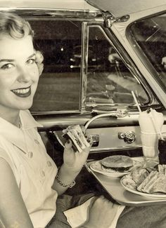Dinner at the drive-in movie theater, 1952..