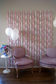 Wall streamer decor...cute backdrop for pictures, present opening!! I wonder if you could use large ribbon for more long-term use (like in a baby's room)? I think that would be so pretty!