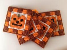 Pumpkin Face Coasters in Plastic Canvas. $7.00, via Etsy.