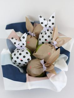 The best way to stow a healthy snack in a basket of candy? Jazz up some apples with these bunny-shaped paper wrappers.