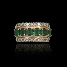 Gold, emeralds and diamonds band ring